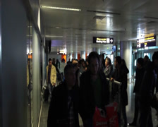 Arrived people go to meeting point at airport after flight, click for HD Stock Footage