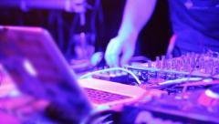 Fat male Dj hands tweaking equipment controls at Dj deck, click for HD Stock Footage