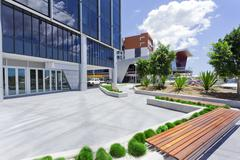 forecourt of modern corporate building - stock photo