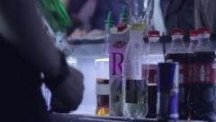 Serving alcohol drinks for visitors in night club, click for HD Stock Footage