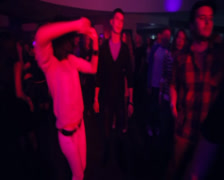 Flying camera above dancing people enjoying in night club, click for HD - stock footage