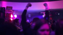Grooving people on the dance floor in night club, click for HD - stock footage