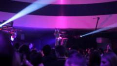 Night club dance floor full of dancing people and disco lights, click for HD - stock footage