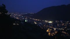 Lit mountain town in night Stock Footage