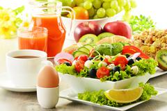 breakfast with coffee, juice, croissant, salad, muesli and egg. swedish buffet - stock photo