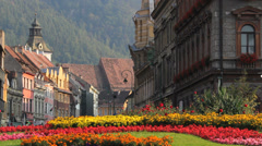 Beautiful view flourish flowers garden in mountain medieval town Stock Footage