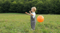 Cute baby play with colored balloon, balloon  break up, baby look disappointed Stock Footage