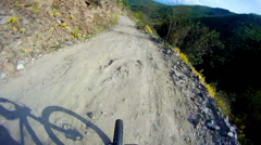 Mountain biker fast downhill sport race ride stock video Stock Footage