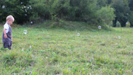 Active baby run to blow bubbles, soap ballons, in nature, son have fun Stock Footage