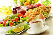 Stock Photo of breakfast with coffee, juice, croissant, salad, muesli and egg. swedish buffet