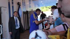 Famous football player signs autographs after soccer match, click for HD Stock Footage