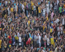 Soccer fans watch football match. Crowd of people on the stadium, click for HD Stock Footage
