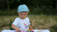 Adorable baby child, smile, laugh happy to paint in nature, feel free to create Stock Footage