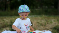 Stock Video Footage of Adorable baby child, smile, laugh happy to paint in nature, feel free to create