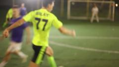 Young footballer tries to score a goal. Youth playing soccer., click for HD Stock Footage