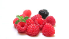 Fresh raspberry, blackberry and green mint leaf - stock footage