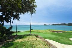 golf course by the sea - stock photo