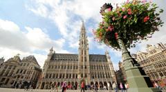 City Hall Brussels Belgium, People walk, spring flowers Stock Footage