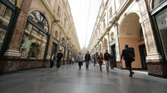 People walking in Saint Hubert Royal Gallery of Brussels Stock Footage