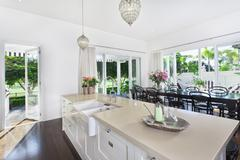 Kitchen and dining area Stock Photos