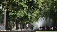 Stock Video Footage of People in park with green trees and artesian fountain, Brussels, Belgium park