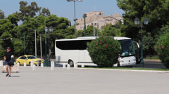 Tour Bus Underneath Acropolis Stock Footage