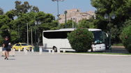 Stock Video Footage of Tour Bus Underneath Acropolis