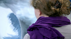 Woman with scarf drawing natural disaster on canvas Stock Footage