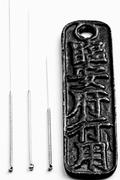 Acupuncture needles Stock Photos
