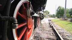 Vintage locomotive departs train station Stock Footage