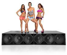 Three seductive girls standing on speakers Stock Photos