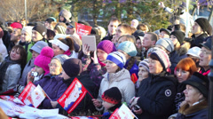 Crowd of spectators at Sochi2014 Olympic torch relay in Petrozavodsk Stock Footage