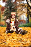 Beauty girl in autumn park Stock Photos