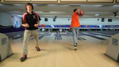excited bowler rolls strikes pins  - stock footage