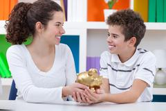 children saving money - stock photo