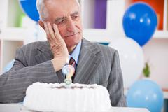 Sad senior man forgot how old is Stock Photos