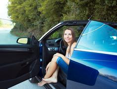 happy caucasian woman in a cabriolet - stock photo