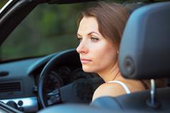 caucasian woman in a cabriolet - stock photo