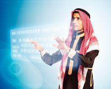 Arab man pressing virtual keybord Stock Photos