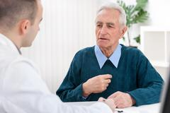 Doctor and an elderly patient Stock Photos