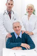 medical team with patient - stock photo