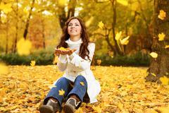 Stock Photo of happy woman enjoying in autumn