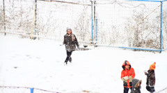 Children playing and gentle snow falling - stock footage