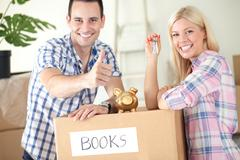 satisfied couple, savings to new home - stock photo