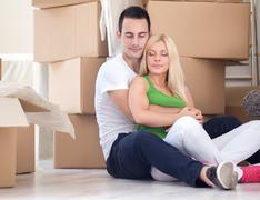 Stock Photo of serene couple enjoying in new home