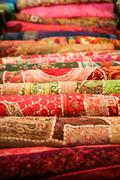 Folded pile of handmade textiles india Stock Photos