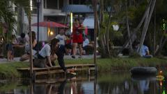 Young Thai Couple Praying and Releasing a Krathong During Loi Krathong Stock Footage