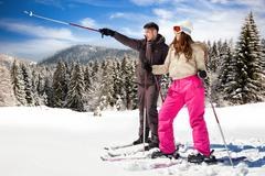 couple with snow skis - stock photo