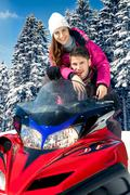 couple on snowmobile - stock photo