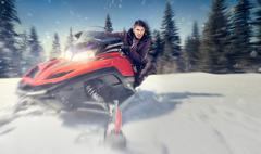 man on snowmobile - stock photo